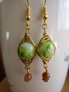 Gold wiire wrapped earrings with green beads.dangle by Polanas