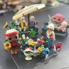 So many lovely flowers which ones shall I get? #lol #lolsurprise #lolsurprisedolls #doll #dollcollector #toys #playmobil #sylvanianfamilies #sylvanians #calicocritters #glitter #lolglitterseries #picoftheday #market #stand #flowers #cactus #umbrella #grandpa #parkbench #bird #rabbit #fun #cute #toyartistry #toyphotography #kicks #rollerskater #sunflower