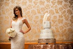 Three tier wedding cake with intricate filigree details and a feather topper | Edible Art Bakery & Dessert Cafe, Raleigh, NC — Edible Art Bakery & Desert Cafe