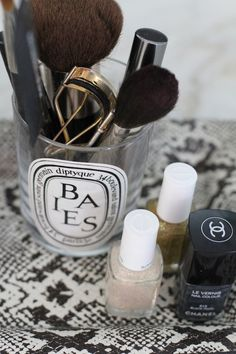 Alex Berlin Of Things That Sparkle - via Glitter Guide Diptyque candle makeup holder organisation, chanel nail polish