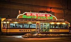 Mickey's Diner is a 10' x 50' classic diner car restaurant, This Original 1930's Diner is in St. Paul, Minnesota.. Yes this in the one that was in the Movie Jingle all the way But the inside in the Movie is NOT the real inside of this dinner it's inside was NOT big enough to film in..  was in Mighty Ducks & A Prairie Home Companion.. Ok now the food try the Famous Greasy Burgers & Malts & Shakes the old fashioned way.. It's a Dive but Good :)
