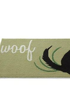 Perfect for your back door or mudroom, the Woof Pet Mat adds charming character to your space while cleaning feet and paws alike.