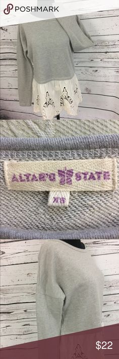 Altar'd State lace trim sweatshirt size XS Altar'd State grey crop sweatshirt with lace peek a boo hem. Super cute with jeans or leggings. Comfy but stylish. Take your sweatshirt game up a notch. Size XS Altar'd State Tops