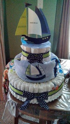 How To Make a Diaper Cake and if you scroll down, they also give you ideas of drinks, appetizers and desserts to serve at a baby shower! Description from pinterest.com. I searched for this on bing.com/images