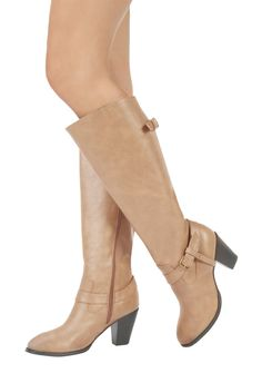 This tall pair of boots is a must-have in every closet this season, no matter what kind of girl!