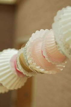 Love the idea of cupcake liners for a garland! Maybe add some paper doilies and perhaps some lace?