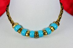 Capture the vintage charm of old Miami Beach in this tropical gold Czech glass and turquoise German acrylic choker with golden filigree beads. $25 at #SmallestPlanet on #Etsy. Get 15% off your entire purchase with coupon code PIN15.