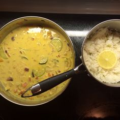 Coconut rice with coconut curry. Based on http://minimalistbaker.com/30-minute-coconut-curry/  Make rice and add .5 cabs if coconut milk to cooking liquid.  Fry one large onion, chopped carrots, chopped potatoes, grater ginger. Cup and a half of veggies. Cook stirring frequently for 5 hot minutes. -- now add can and a half of coconut milk, curry powder, cAyenne, and 1 cup of water, and salt. Add tomatoes and zuchini 1 cup. and garlic for the last 5 minutes.  Serve with lemon and green onions.