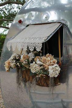 Vintage camper with rear-window box