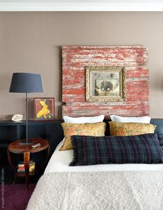 Black watchplaid and Ralph Lauren floral intetestingly juxtaposed with barnwood and gold molding frame