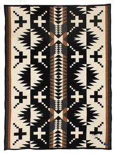 Pendleton's jacquard throw is just the right size for napping, reading or simply admiring. Toss over a sofa or chair, or fold at the foot of the guest bed. The intricate, Native American-inspired design is sure to be a conversation starter wherever it lands. Woven in Pendleton's Northwest mills