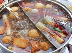 Chinese hot pot is truly communal: Not only do you sit down to eat with all your companions, but you cook the food together in the same pot of simmering broth.