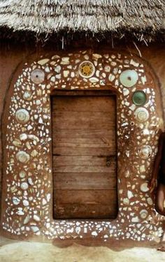 Northern Ghana, photo by Herbert Cole. Link takes you to a beautiful collection of windows and doors with no words...