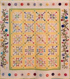 "My Florida Sunshine Garden Lap Quilt 03 ""I wanted to express in a quilt my love of Florida sunshine and all the beautiful flowers we can grow. In this quilt, I have experimented with using vibrant colored yo yo's in the border along with appliqué to represent my Florida flower garden."""