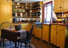 Primitive Kitchen...with mustard painted cupboards & open shelving.