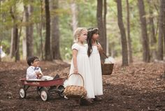 Okay, the flower girls pulling the ring bearer in a Red Flyer wagon pretty much stole our hearts! Click to view more from this romantic Chattanooga wedding with a rich woodland feel, featuring flowers by @mayflowerscha, photographed by Imago Photography! | The Pink Bride www.thepinkbride.com