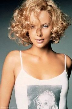 Charlize Theron cute curly bob.  So, if I cut 2 feet off my hair...I wonder if it would do this, or if I would look like a q-tip?
