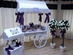 Lynne's Candy Carts & Wishing Wells, based in Barnstaple #Devon offer that special touch for your wedding. Beautiful handmade candy carts, wishing well post box, and topiary trees for hire. Decorated with your choice of ribbon colours + personalised handmade signs. Perfect for your sweet buffet or available to display your wedding cake or cup cakes. Cost includes travel radius up to 10 miles, max 20 miles. £157.50 (10% off) www.weddingdeals.co.uk Lolly Buffet, Candy Buffet, Wedding Sweet Cart, Tantrums And Tiaras, Vintage Candy Bars, Candy Stand, Sweet Carts, Sweet Buffet, Cake Pop Stands