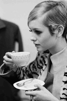 Twiggy drinking coffee