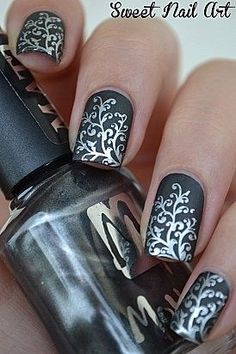 Amazing nail art! Silver leafy pattern on black matte polish. Gorgeous! #nailart | #clairetaylormua