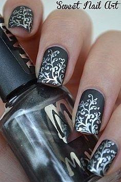 Amazing nail art! Silver leafy pattern on black matte polish. Gorgeous! #nailart | #clairetaylormua