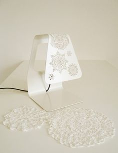"""Specialized in metal products, """"Doily Sisters"""" light collection was a result of a collaboration between deZign Studio with Italian company Lamidea. This"""