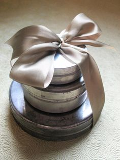 Vintage Canisters. 25 Creative Gift Wrapping Ideas --> http://www.hgtv.com/handmade/25-creative-gift-wrap-ideas/pictures/page-21.html?soc=pinterest