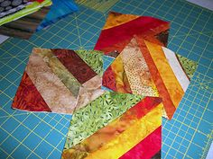What is a STRING QUILT?  Short tutorial on sew-and-flip string quilt blocks technique.  Link to a Tic-Tac-Toe pattern is given.