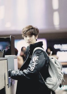 Luhan EXO wearing that deer-in-the-headlights look again.
