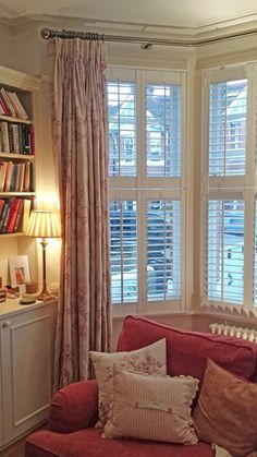 Bay Window with curtains tier on tier shutters