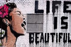 Need and want this for my dining room area. Life Is Beautiful by Banksy Canvas Print