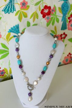 Semi Precious Stones along with Fresh Water Pearls and touches of Rhinestone sparkle!