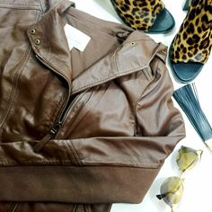 "Brown Leather Hooded Jacket Deatils: • Size L • Rib knit trim under arms • Bust: 18.25"" across when laid flat • Length: 22.5"" • Sleeve: 18.75"" from arm pit to end • Fabric content: 100% leather • NWT  11271505 Hinge Jackets & Coats"