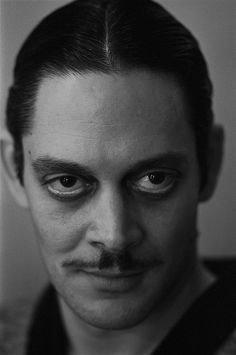 Raul Julia as Macheath in Joe Papp's production of The Threepenny Opera at Lincoln Center, June by James Hamilton for the Village Voice Old Hollywood Stars, Hollywood Glamour, Adams Family Halloween, Raul Julia, Gomez And Morticia, Monochrome, Addams Family Characters, Cinema, The Munsters
