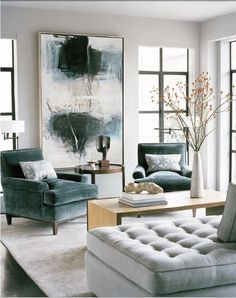 i would like everything in this photo, please: giant painting, velvet laid-back arm chairs, 3-sided coffee table, grey tufted chaise.