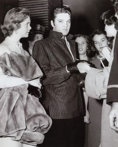 Elvis at the Louisianna Hayride in december 15 1956 for his last show at the Hayride . Here with fans.