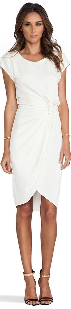 Stunning White classical dress for the office, paired with a black blazer for the evening.