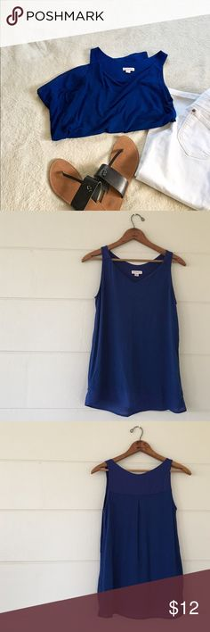 Merona tank top Merona brand blue tank top size xsmall. Knit:  96% rayon 4% spandex woven: 100% polyester. Bust is 38 inches length is 23 inches. In excellent condition Merona Tops Tank Tops