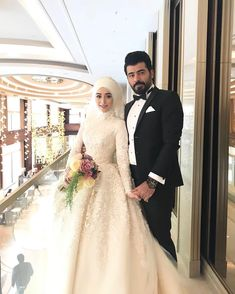 Image may contain: 2 people, people standing and wedding Wedding Hijab Styles, Muslim Wedding Dresses, Muslim Brides, Indian Wedding Outfits, Short Bridesmaid Dresses, Muslim Wedding Gown, Wedding Gowns, Couple Photography Poses, Bridal Photography