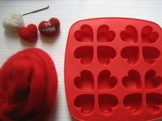 Needle felting hearts in a mold