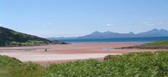 Scotland.  The bay at Sand with Raasay, and the Cuillins of Skye in the background.