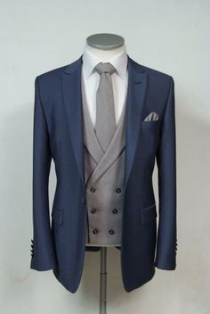 he newest collection to our hire ranges is this Steel blue wool & mohair slim fit grooms wedding lounge suit available from stock from July 2015 shown here with a. Wedding Suit Hire, Wedding Suit Styles, Grey Suit Wedding, Wedding Men, Wedding Lounge, Blue Wedding, Blue Suit Grey Waistcoat, Blue Suit Men, Navy Blue Suit