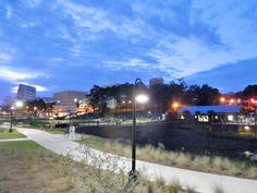 Tallahassee: A night time view from Cascades Park. Photo by Gloria Ford Cascade Park, Night Time, Sidewalk, Ford, City, Beach, Beautiful, The Beach, Side Walkway
