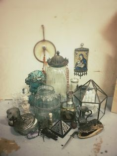 A collection of esoteric objects and old jars create a still-life with a taste of the Gothic.