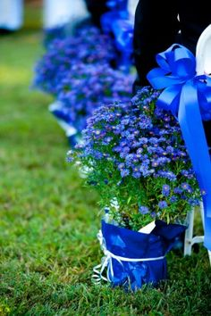 Find some pretty blue potted flowers and have them every other row in the chapel... then move them to the reception site and after dinner allow guests to take them home. Make the pots blue simply by covering them in blue wrapping paper or fabric and tying with a silver ribbon.....reception idea?  Only with Burlap and Lace at the bottom?