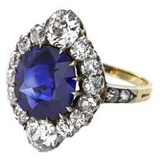 Edwardian Fine Burmese Sapphire Diamond Cluster Ring | From a unique collection of vintage cluster rings at http://www.1stdibs.com/jewelry/rings/cluster-rings/