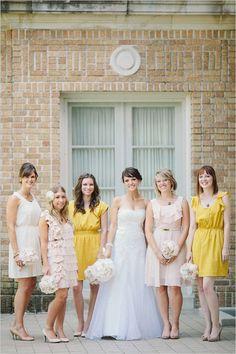 cream, light pink and yellow bridesmaid dresses