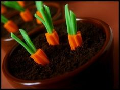 Easiest dessert ever: chocolate pudding cups with rainbow Twizzler carrots. | 28 Insanely Easy Ways To Get Ready For Easter