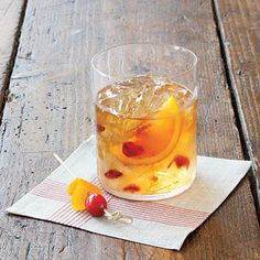 Cranberry Old Fashioned Cocktail | When the crowd breaks for halftime, impress your guests by bringing out a round of Old Fashioneds, garnished with fruit and made with a secret ingredient: whole-berry cranberry sauce. | SouthernLiving.com