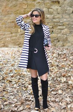Striped coat, Louis Vuitton Clutch, high boots and black dress